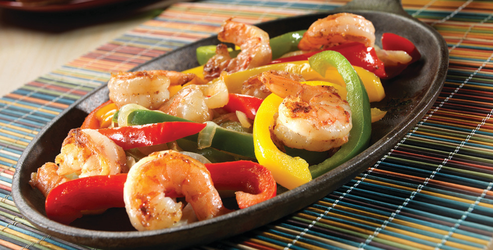 Shrimp Fajitas in Skillet on Table